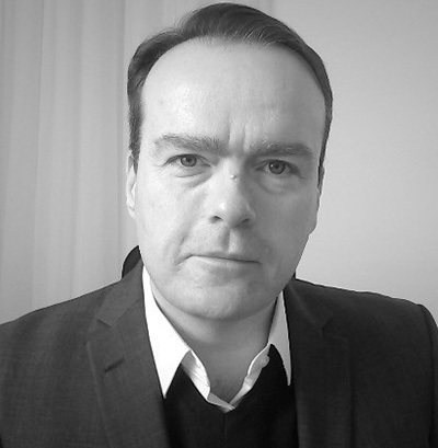 Photo of Dr Gregory Burke MA (Cantab.) MPhil. PhD